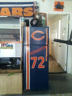 DIY - Chicago Bears Refrigerator! This is our garage and the kind of projects my husband spends his time doing. Can you say fanatic!!