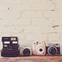 Cameras! I want that Fuji Polaroid (the pastel one) SOOOOOO BAAAADDDD!!! please I WANT