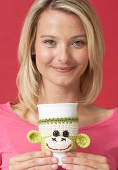Brighten up your morning coffee with a grinning sock monkey cup cozy! This cozy that stretch to fit the cup, making this a great little gift for your favorite coffee fan. Shown in Patons Classic Wool.