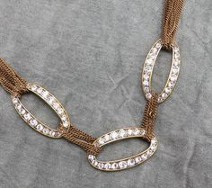 This Monet necklace, with 12 strands accented with rhinestones, will be a show stopper with your ensemble. | eBay!