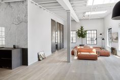 SoHo Loft is a minimal interior design located in Soho, New York, designed by Nusla Design. The building was formerly the silver factory for Tiffany & Co. jewelers. Given the significant history, it was important that the original details were maintained and restored while updating with newer elements and functionality. The dropped ceiling was removed, the double-hung wooden windows were restored and the brick walls were exposed. New wide board floors were treated using a traditional…