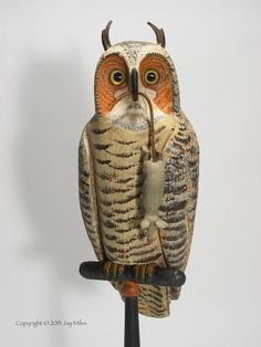 Great horned owl with mouse carved by Jay Miles.  Mouse has leather tail which inserts into bill.  Leather ears.  See our latest carvings at Kicking Bull Gallery on Facebook.
