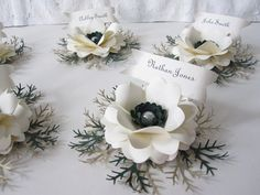 Paper flower place cards ... these are for a wintry setting but other flowers can be used for spring, fall, Christmas, etc.