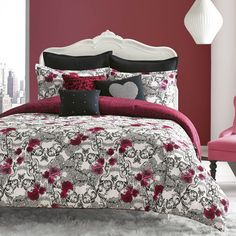 Romantic pink and red roses are scattered over a black and white scrollwork background in a deceptively sweet design. But, in true Betsey Johnson fashion, there is a suprising edge to this print. Take