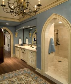 Shower behind the sinks...... It's kinda like a cave......& you don't have to worry abolut cleaning shower door. I Love the color too! so cool