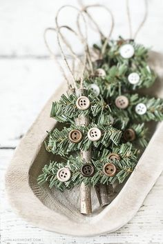 Make this Rustic Holiday Ornament in less than 10 minutes! Kelly of Live Laugh Rowe created this simple, rustic Holiday Ornament using a stick, faux pine stem and buttons. This wooden tree would also. Rustic Christmas Ornaments, Homemade Christmas Decorations, Handmade Christmas, Christmas Fun, Ornaments Ideas, Christmas Design, Button Ornaments, Ornaments Design, Elegant Christmas