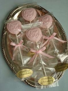 12 Vanilla, white chocolate heart Sweet Sixteen Lollipops 16 Birthday Party Favors Candy Treats. $22.20, via Etsy.