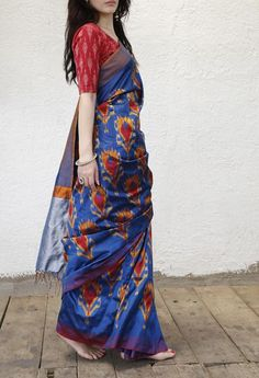 Blue tulip pattern saree in pure silk fabric. With attached blouse. handwoven ikat with AZO-FREE dyes. Prices exclusive of tax and shipping. Ethnic Sarees, Indian Sarees, Indian Dresses, Indian Outfits, Indian Clothes, Indian Attire, Indian Wear, Ethnic Fashion, Indian Fashion