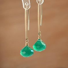 Gorgeous microfaceted Forest Green Onyx briolettes are wire wrapped and simply dangling from handmade polished long earwires. These stunning Natural Gemstone Earrings are handmade by BoutiqueBaltique. Available in 14k gold filled, 14k rose gold filled or sterling silver. Onyx is the birthstone for Leos and the anniversary gemstone for the 7th year of marriage. stone for releasing negative emotions and therefore brings good fortune and helps in recognizing personal strength.