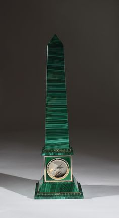 A malachite, green guilloché glazed & silver plated Obelisk; the cubic base houses an automatic watch with a charge of one week. The obelisk and its mechanics were entirely hand-made; Rome, Peppino Capuano, Via Condotti, 1991 - Dim: H. cm. 40