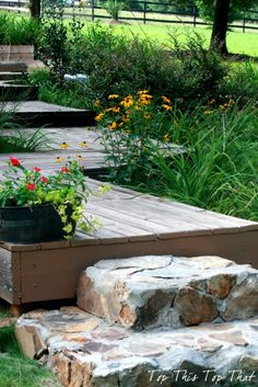DIY Stone Steps from 'Top This Top That' I like how the flower containers are integrated into the wide steps.