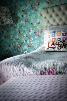 Love the wallpaper and the laugh cushion! xxx