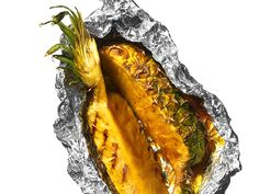 Glazed Pineapple The classic grilled pineapple gets kicked up a notch with the addition of a spiced butter with curry powder and dark rum