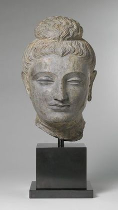 Head of a Buddha, Gandharan style, 2nd century Sculpture , Head Gandharan , 2nd century AD Kushan period, c.100 BC-250 AD Creation Place: Gandhara, Pakistan