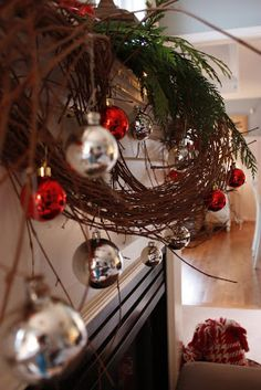 I had only one objective for this years Living Room Christmas Mantel... keep the grapevine garland that I used for my Thanksgiving Mante...