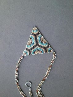 This is a listing for Aurora Sky beaded necklace tutorial, you will not receive the jewelry pictured above. I love geometric beadwork. I especially adore triangles. They are so cute and so fun to make. This time I wanted to create a large triangular pendant-different than the typical