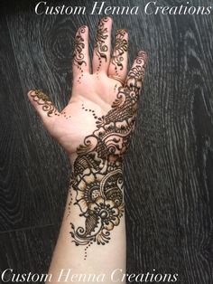 Floral mehndi by Custom Henna Creations.