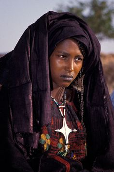 Niger | Tuareg lady and cross ~  Tuareg Crosses often used as a form of currency…