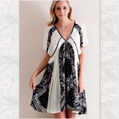 HP⚫️Black & White Bandana Dress⚫️ Lovely black and white dress! Beautiful v-neck! Pairs nicely with a denim jacket & boots or even a pretty cardigan and flats! This is a great wardrobe piece! PP Trades  Holds Made in the USA annABelle's boutique Dresses
