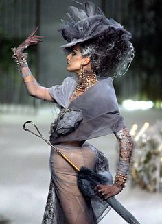 In 2005, Dior released this bustle-inspired piece. Here we see a modern interpretation of the bustle, along with an over-the-top and heavily decorated hat - not unlike the massive hats and bonnets from the Bustle period.