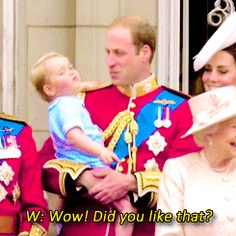 Prince William talking to Prince George on the balcony of Buckingham Palace at Trooping the Colour 2015.
