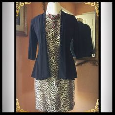 Cheetah Print Dress Go wild in this gorgeous cheetah print shift dress. Dress it up with your favorite accessories. You can never go wrong stepping out in this dress. Size is 16P Besty's Thing Dresses Midi