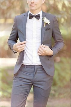 Grey suit and bow tie for the modern groom