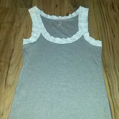 Grey tank top with lace shoulder straps Grey tank top with lace shoulder straps and neck 93 cotton and 7 spandex GAP Tops Tank Tops