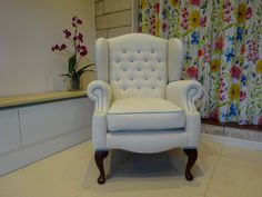 Re-upholstered armchair with floating button detail and contrasting piping.   By Kirsty Lockwood Furnishings www.kirstylockwood.co.uk