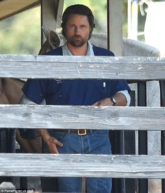 Rancher: Henderson, from New Zealand, wore jeans and a blue shirt for the scene