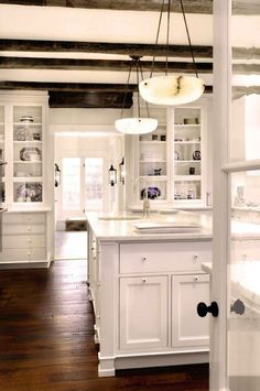 Foot detail on island, light fixtures, beams, build-ins // Add Character with Beams - Design Chic