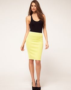 A yellow pencil skirt is demure enough to incorporate this trend into your work wardrobe.