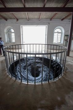 A Perpetual Whirlpool of Black Water Installed in a Gallery Floor by Anish Kapoor  http://www.thisiscolossal.com/2015/02/anish-kapoor-decension-vortex/