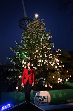 British model Daisy Lowe poses for a photo during the official opening of the Macmillan Tree of Light with NatWest at the Southbank Centre on December 10, 2014 in London, England. The Macmillan Tree of Light, made possible by NatWest is a 30ft high Christmas tree at  the Southbank Centre's Winter Festival where people are invited to write a message of love, hope or remembrance on a decoration for a small donation to Macmillan Cancer Support.