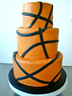 Basketball Cake...cute with football and baseball layers too!