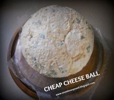 Cheap Cheese Ball...a yummy pineapple cheese ball! You can coat it with almonds or crushed pecans, too! Serve with your favorite cracker!
