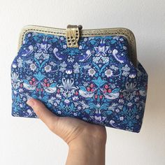 Elegant and cool blue strawberry thief handmade frame purse, available on unebonnejournee etsy and alm boutique  #strawberrythief #libertyprint #libertyaddict #libertystyle #williammorris #coolblue #elegance #bluebag #handmadewithlove #framepurse #libertylondon #etsyshop #alittlemarket #pochetteliberty