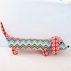 doxie!  I had a handmade blue one much like this one with stripes on the inside of his ears. sigh.