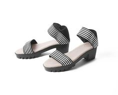 This is a Shoe Market best seller! It looks great on the foot the elastic makes an easy secure fit, without buckles or laces. Black White Stripes, Black And White, Spring Sandals, Charleston, Heeled Mules, Looks Great, Heels, Closet, Products