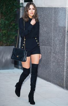 Punch up head-to-toe noir a la Olivia Culpo in gold-embellished shorts and thigh-high boots.