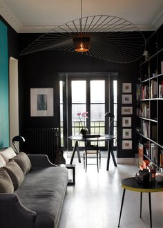 Dark navy/black walls with bath tile?:: great lighting, black walls opening to turquoise blue beyond, white floors