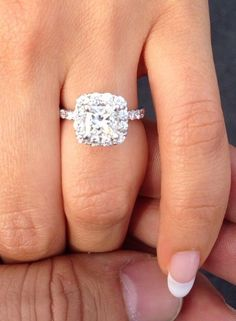 Princess cut diamond with halo engagement ring