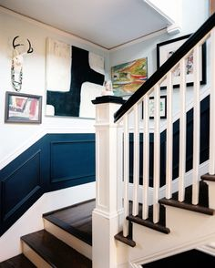 A contrasting painted swath, embellished with crown molding and capped with a chair rail, perfectly matches this stairwell's chunky banister.    find more stylish staircases at Lonny.com in our Ideas section!