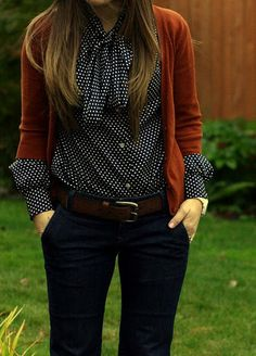 Work. Fall. Casual Friday. Orange cardigan, navy blue and white polka dot bow blouse, navy blue slacks and brown belt