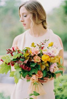 Natural Wedding Bouquets: Colorful Ranunculus, Roses, Tulips, and Greenery | Brides.com
