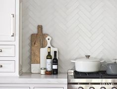 these tiles could be stacked behind sink wall and used in herringbone pattern behind range