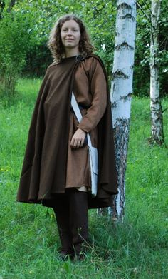 full reconstruction of garment found in Bocksten (Sweden). Surviving pieces are woolen hose, tunic, cloak and hood. You can see on the left brown woolen semicircular cloak of this pattern. Dress is entirely hand sewn. (half of 14th century)