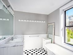 PHOTOS: Amy Schumer's Manhattan Apartment Is What N.Y.C. Dreams Are Made Of | THE BATHROOM | Located in the master suite, the bathroom boasts a clawfoot soaking tub and separate shower – you know, if you need a break from luxurious bubble baths.