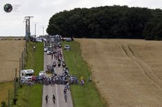 The pack of riders is stopped after a fall during the sixth stage of the 99th Tour de France cycling race between Epernay and Metz. BOGDAN CRISTEL/REUTERS