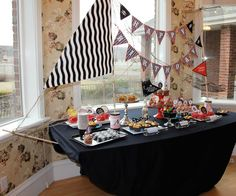 Pirate Birthday- decorate the snack table as a ship- so doing this when B has a pirate party!!